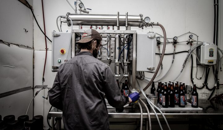 Swans Brewery staff applying labels by hand