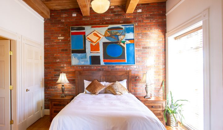 Hotel bedroom with brick walls