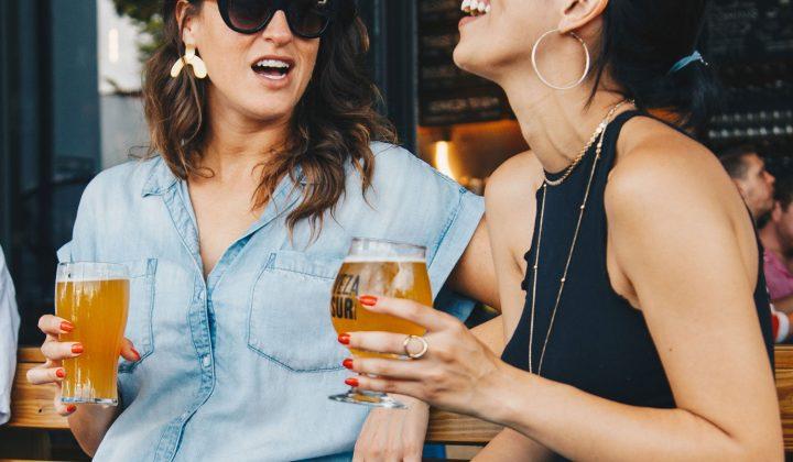 Laughing folks enjoying a beer